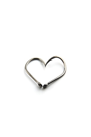 Focus The Hooks for fishing on white Background,A heart-shaped hook. photo