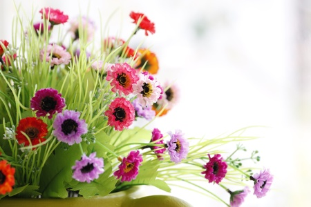 Flowers in a Green vase and Colorful Flowers. photo