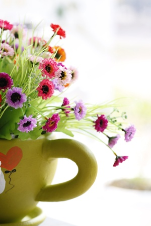 Flowers in a Green vase and Colorful Flowers.