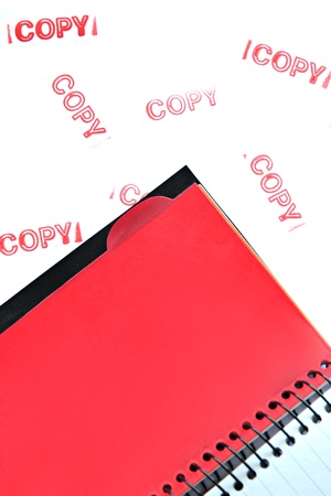 objec: Notebook resting on a white background and the text written on the copy.