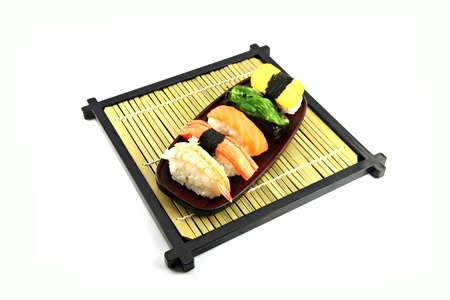 The set Sushi in the dish on the white background.