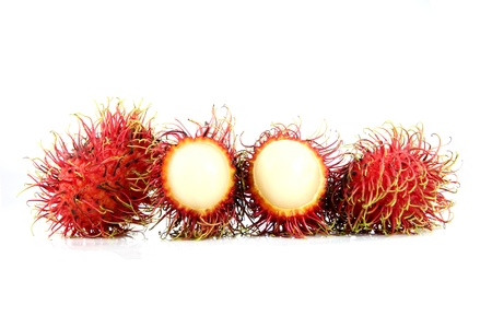 peeled off: Rambutan Fruit is Peeled off on the white Background Stock Photo