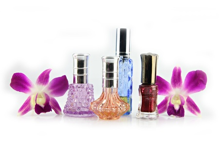 The Purple orchid and Perfume bottles on the white background. photo