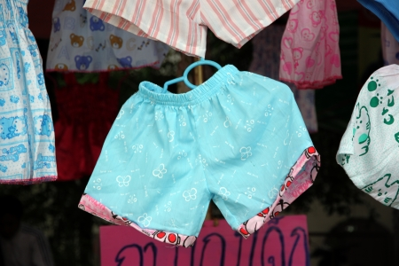 were: The Childrens Shorts were hanging in the market. Stock Photo