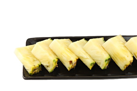 agri: Focus Pineapple slice in the black dish. Stock Photo