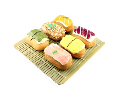 Mix color Sushi Donuts in bamboo dish on white background  photo
