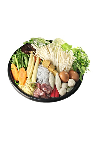 Ingredients Sukiyaki in dish on white background. photo