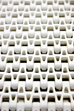 Closeup The Picture Patterns of white plastic with a conveyor belt. photo