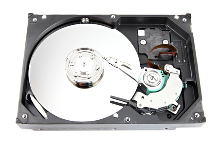 diskdrive: The Hard drive Open the top cover off on white backgroun.