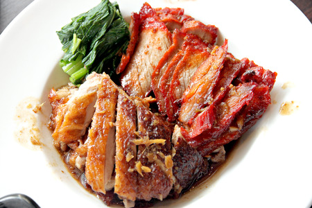 admixture: This Thai foods of Grilled Duck meat and pork in white dish.