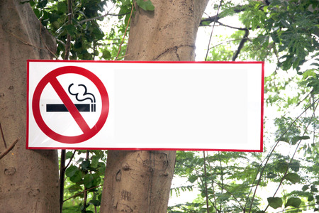 disallow: The Post Stop Labels smoking on tree background  Stock Photo