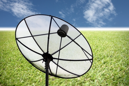 The Picture Satellite dish on the grass and blue sky. Stock Photo - 23368515