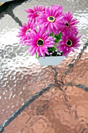 Purple flowers on the table glass and Patterned has mirror  photo