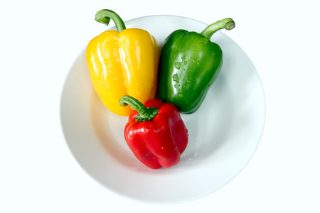 The Three colored bell pepper in white dish