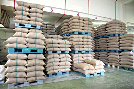 Stacked of Rice sacks on Plastic Pallet in warehouse