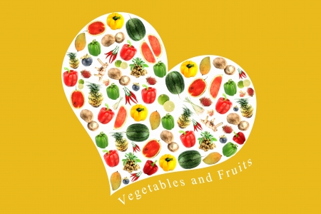 Vegetables and fruits on a white heart,It reflects the care and love to eat good food  photo