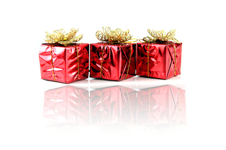 Red gift box with gold thread attached. photo