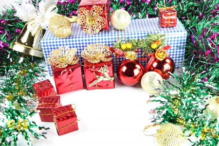 Gift Box and red ball of decorations in Christmas or New Year. photo