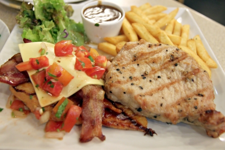 Pork Steak with French fries in dish  photo