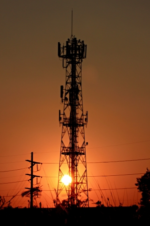 Sunset of Phone antenna with Silhouette. photo