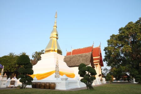 Gold pagoda in Thailand,Places of worship Buddha Relics the name is Phra That Kham Kaen. photo