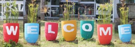 welcome sign: Concevoir signe Bienvenue � base de jardini�re color�.