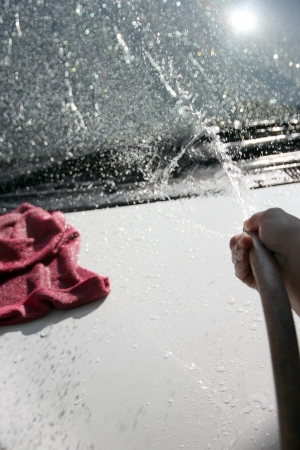 water hose: White car washing Front windshield with Water hose in house. Stock Photo