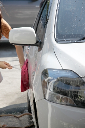 water hose: White car washing with fabric and Water hose in house.