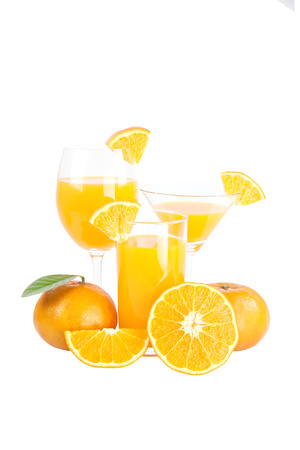 Mandarin oranges and glass isolated on white background. photo