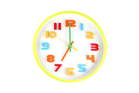 seven o'clock: Colorful clock in telling time of seven oclock on white background. Stock Photo