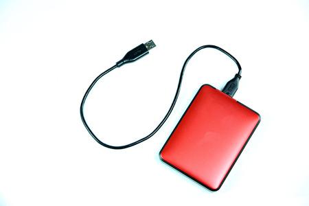 gigabytes:  Red external hard disk isolated on white background.