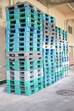 negligent: Plastic pallets are stacked can cause accidents in factory.
