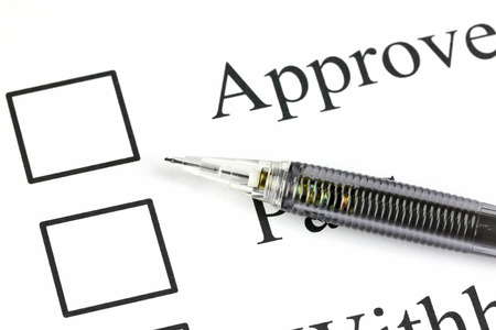 Closeup Mechanical pencil point to Checkbox in approve text. Stock Photo - 26477399