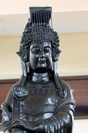 deity: Black deity statues of Chinese religion in temple. Stock Photo