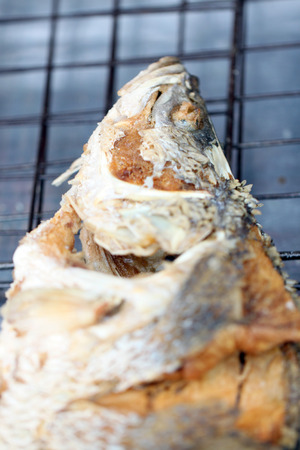 lates: texture of seabass or lates fish deep fried local foods in Thailand.