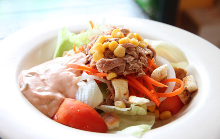tuna and vegetable salad in dish at restaurant. photo