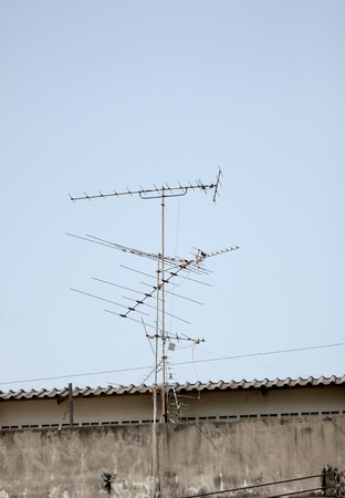 housetop: Antenna in receive TV signals on housetop.