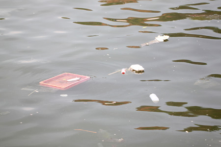 many of Rubbish floating in the sea. photo