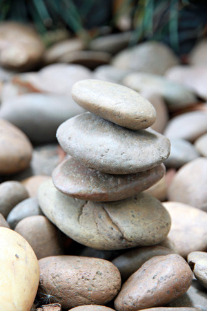 Stack of round smooth sand stone in the garden.