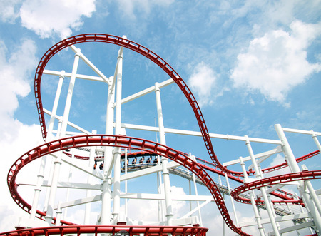 Roller of coaster against blue sky in amusement park. Stock Photo