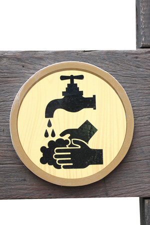 indicates: Signs of symbols indicates a clean hand on wood background.