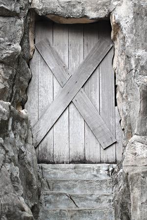 impervious: Old wooden door is closed it forbidden.