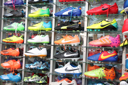 Football shoes of renowned brands (Nike) sold at sports shop in Pattaya market.