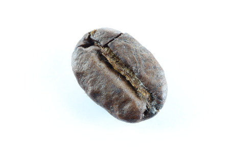 Brown coffee beans on white background. photo