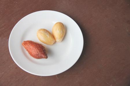 salak: Fresh salacca edulis salak palm fruit of peeling in dish on the foods table.