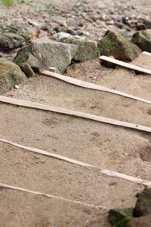 sandy soil: Stairs were made of sandy soil in the garden.