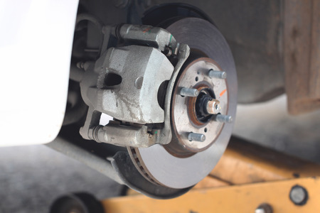 repaired equipment of car brake disc in the garage. photo