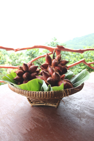 salak: Fresh Salak snake fruit in basket on the foods table. Stock Photo