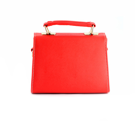 Red handbag of texture leather isolated on white background. photo