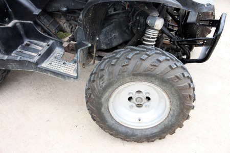 rotational: Car Wheel of ATV on stop.